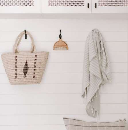 items hanging on wall hooks for simple living