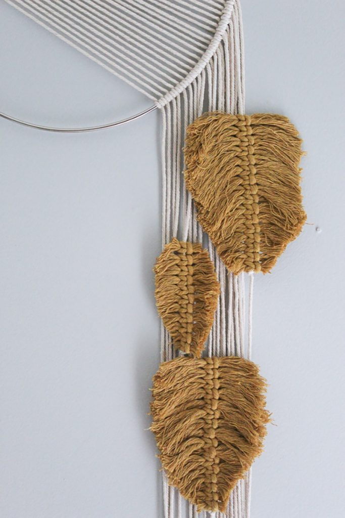 Mustard colored macrame feathers hanging on strings