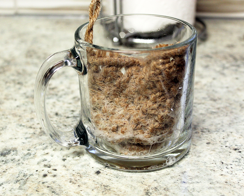macrame pot scrubby inside a clear glass coffee mug