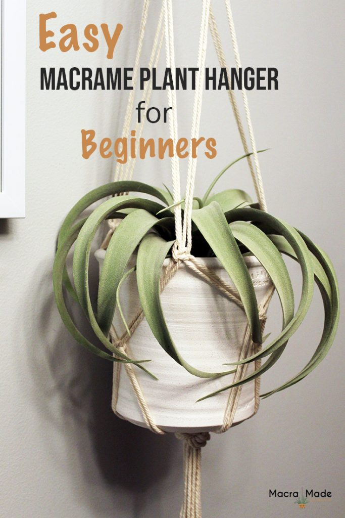 white pot with plant hanging in a macrame plant hanger image to pin to pinterest