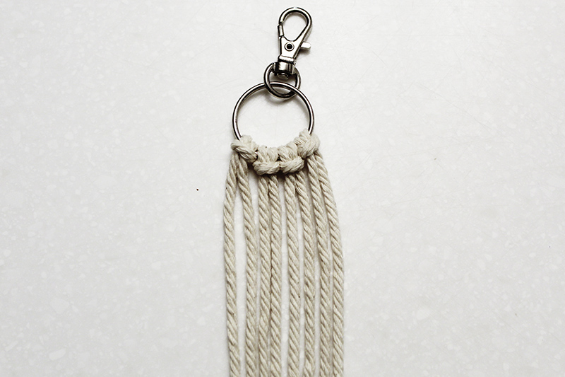 macrame string added to the keychain ring with lark's head knots