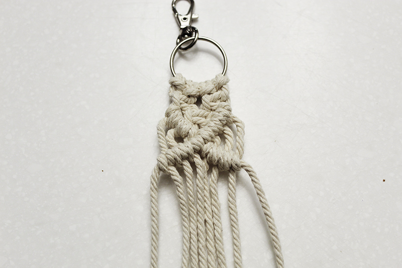 macrame keychain with square knots bordered by half hitch knots