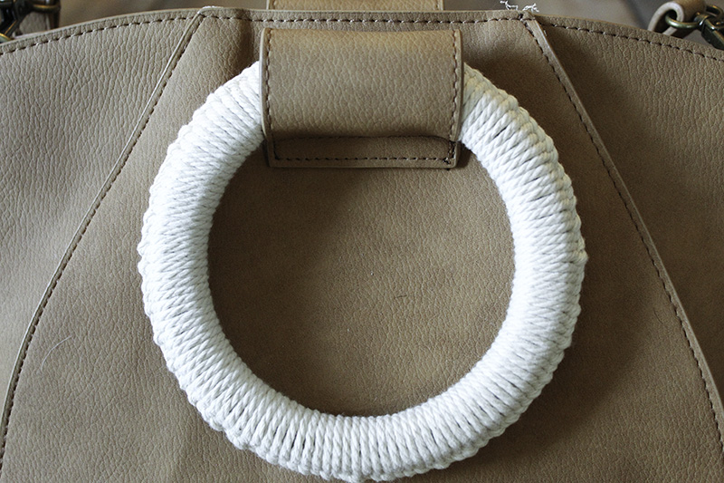 close up of natural macrame string on purse handle