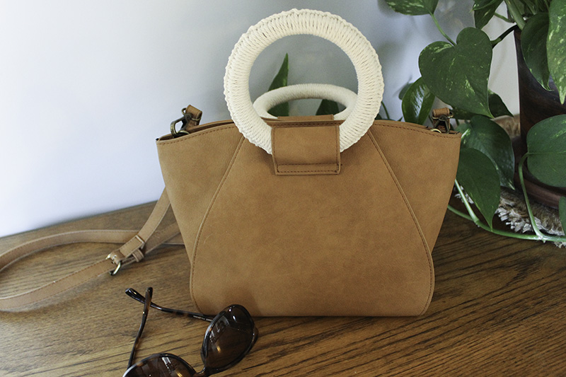 brown leather purse with macrame detail on the handle