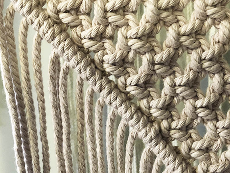 macrame rope tied in half hitch knots bordering square knots