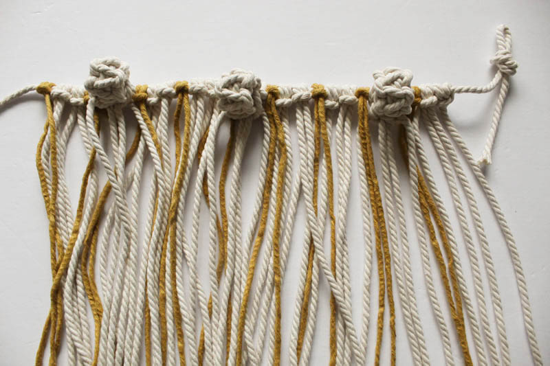 macarme garland with natural and gold string