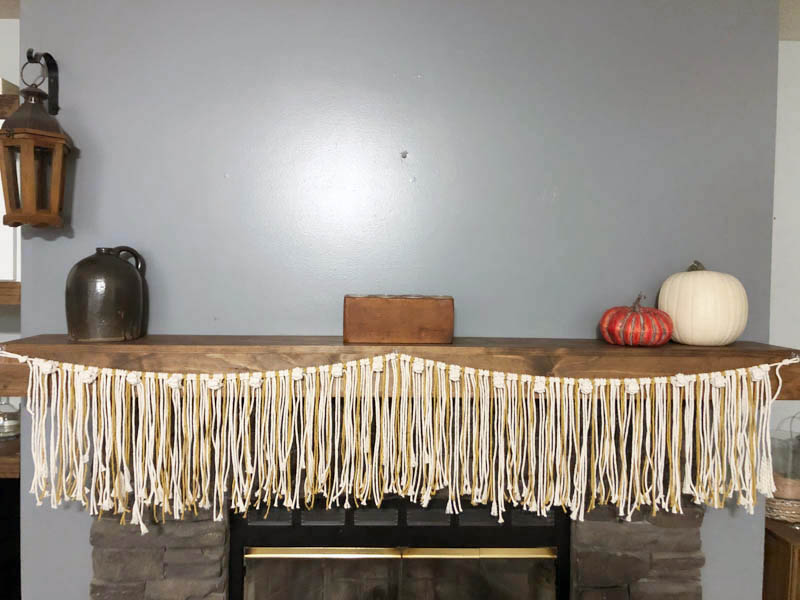 fall macrame garland hanging on the mantle