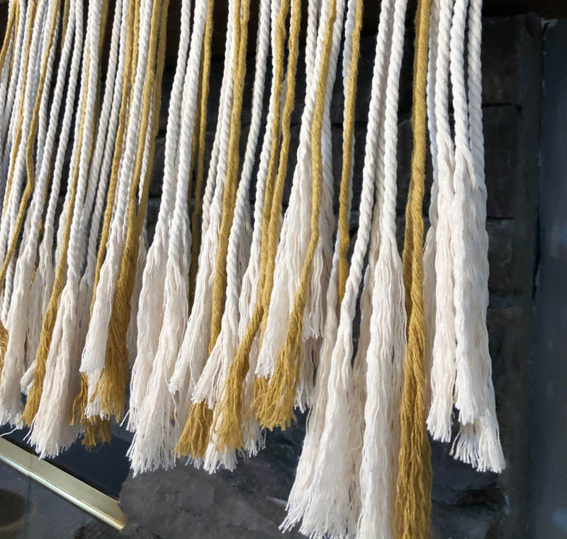 ends of macrame garland combed into fringe