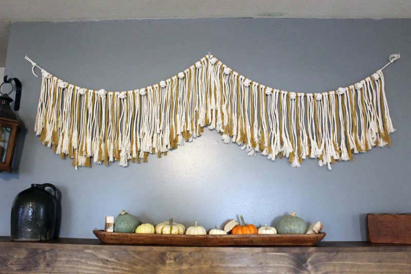 simple macrame garland hanging on the wall above the fireplace