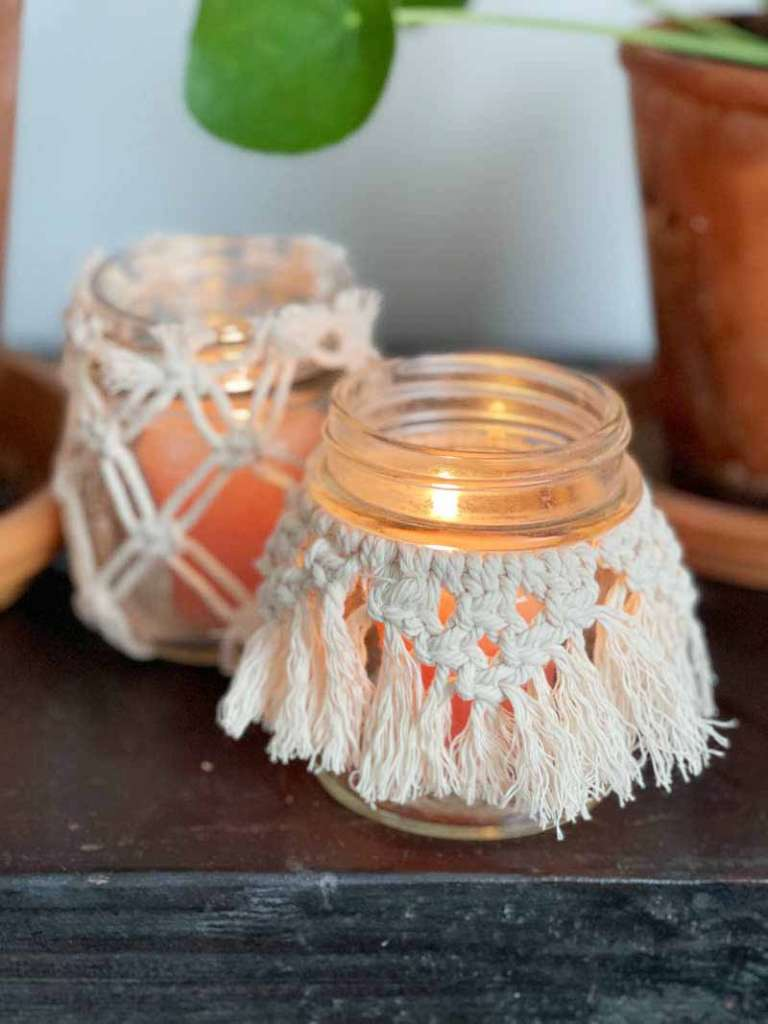 two mason jars with macramé mason jar covers