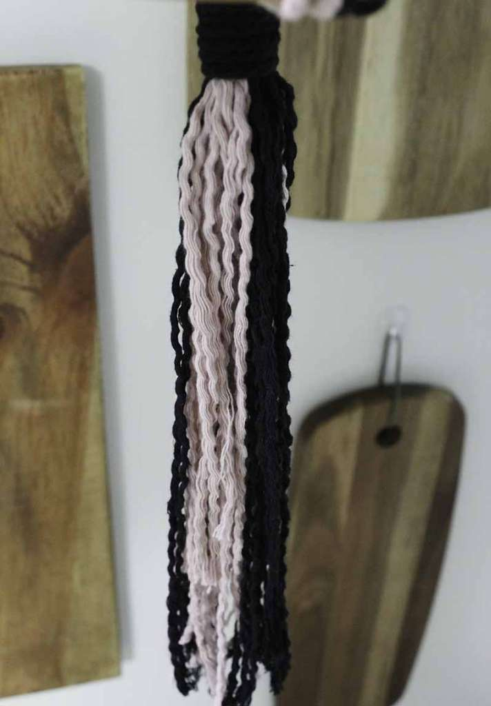 pink and black strings unraveled and wavy