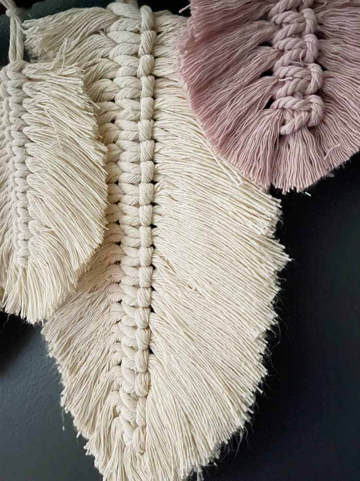 feathers on wall hanging after starch and hairspray used to straighten them