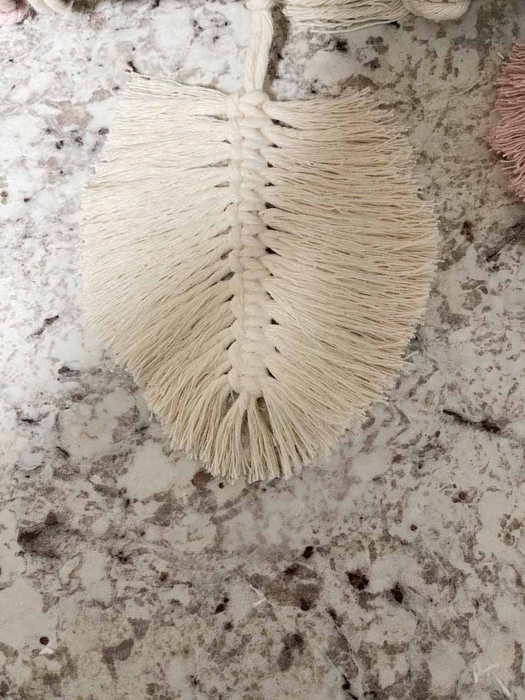 natural colored feather with spray starch