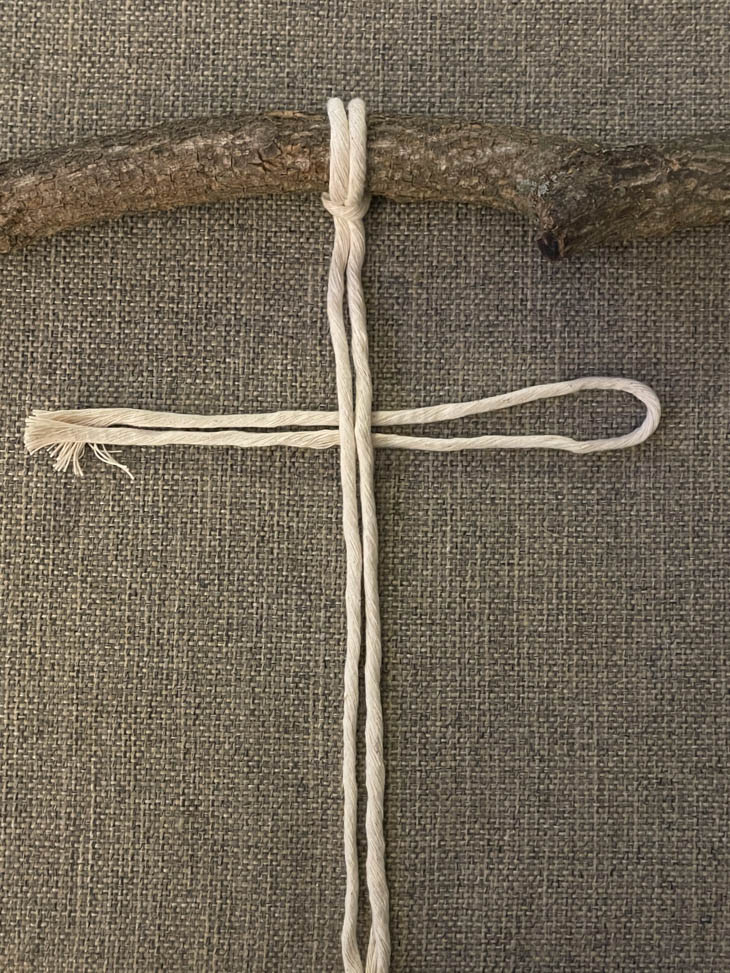 macrame string on branch for macrame feather wall hanging