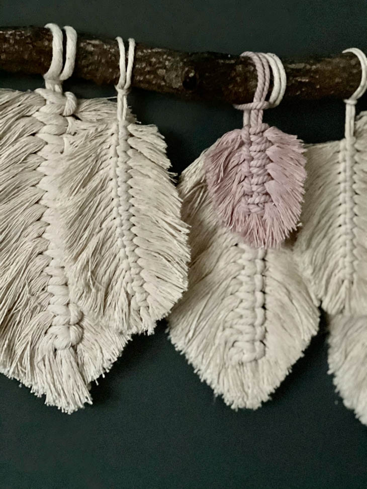 close up of feathers on finished macrame feather wall hanging