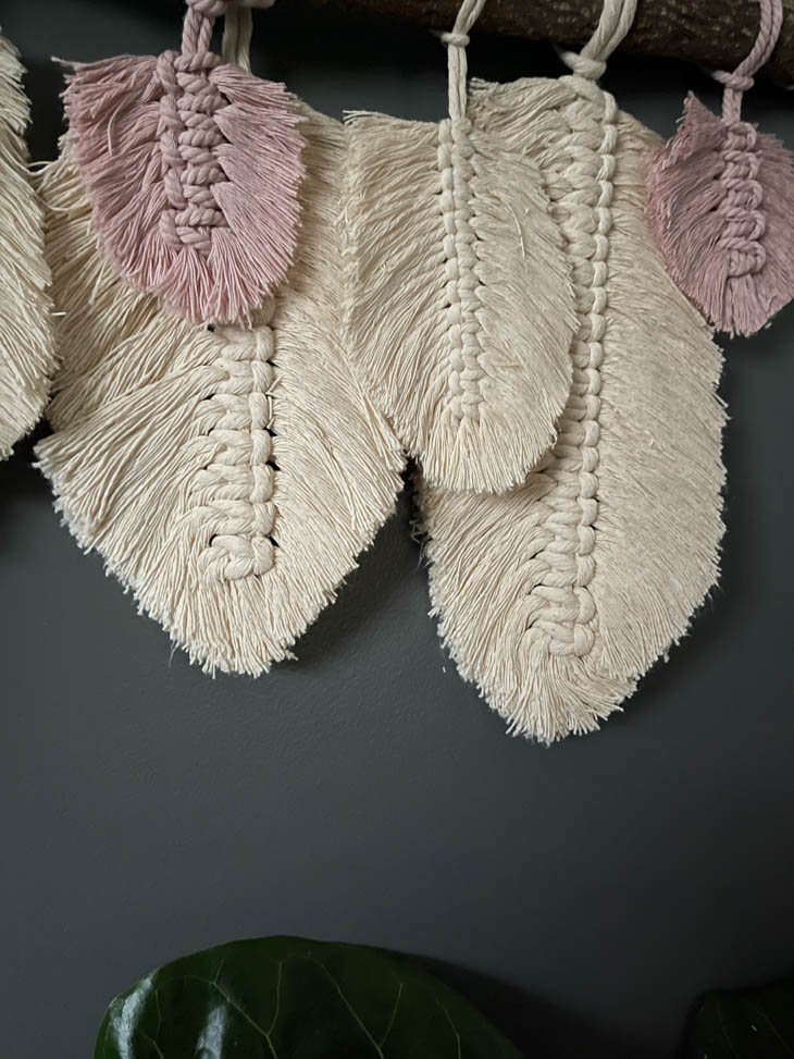 finished macrame feather wall hanging