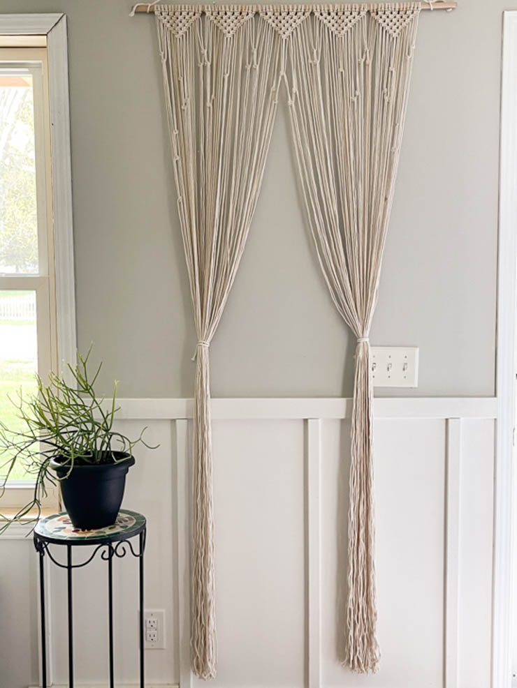 macrame door curtain divided and tied back like a curtain
