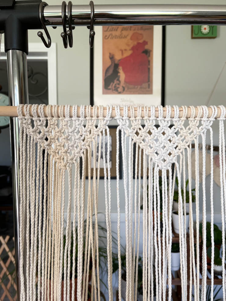 two triangle shapes tied with square knots on macrame door curtain